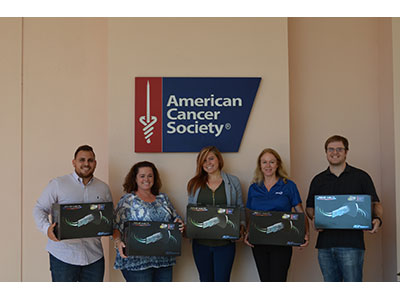 Group photo of ACS employees holding REME HALOS