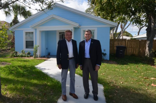 Photo: Ron Fink, RGF President/CEO and Bernie Godek, CEO, Habitat for Humanity of Palm Beach County in front of a Habitat Home.