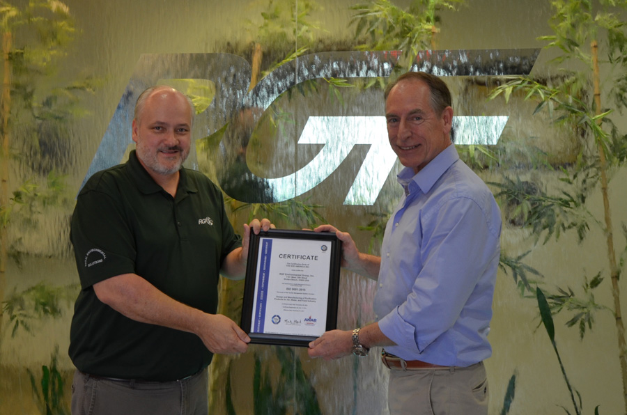 Walt and Milt holding ISO certification