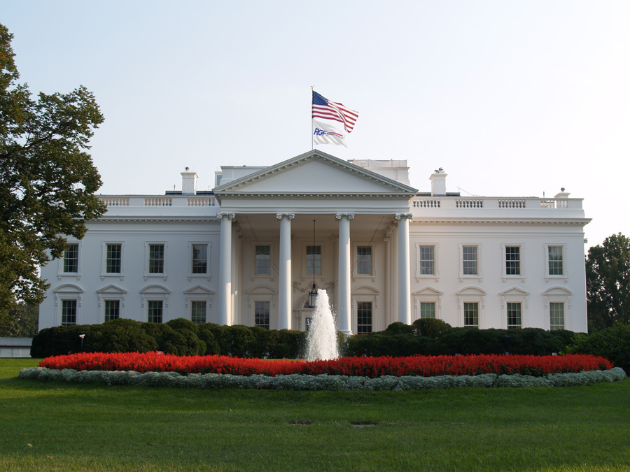 Whitehouse with American and RGF flags